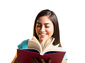 Young woman holding book and going through pages