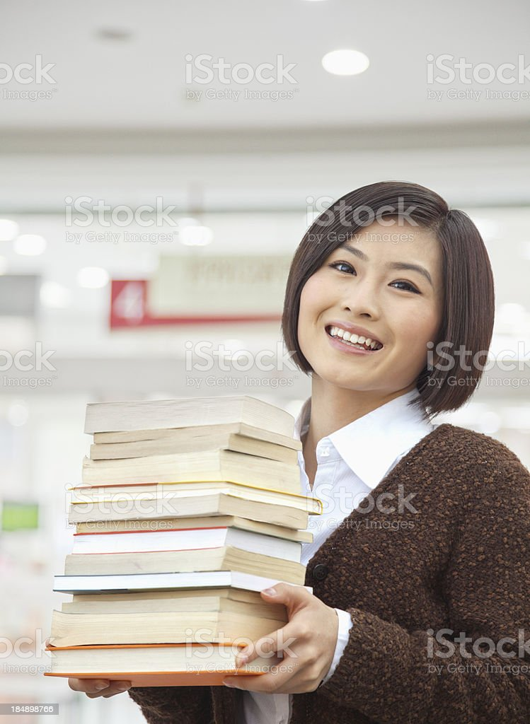Young Woman Holding Books royalty-free stock photo