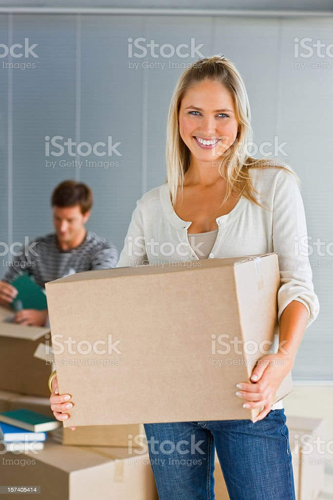Young woman holding box royalty-free stock photo