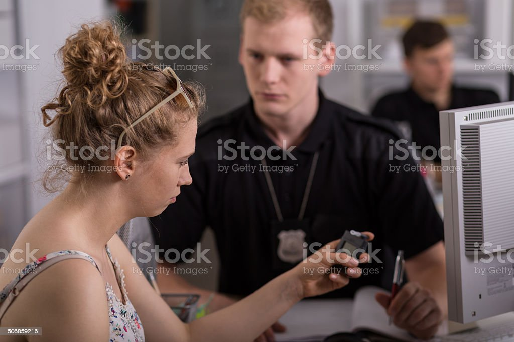 Young woman holding breathalyzer stock photo