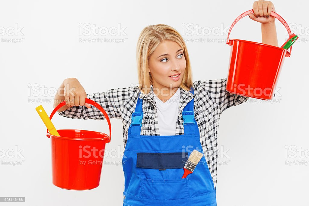 Young woman holding buckets with paint stock photo