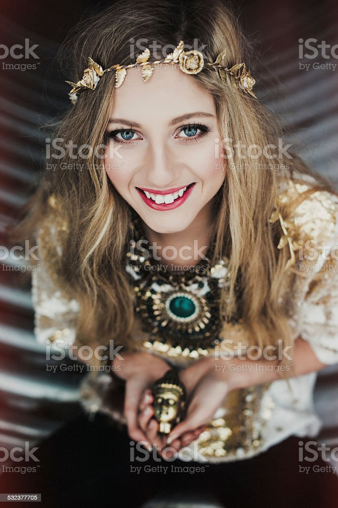 Young woman holding buddha statue stock photo
