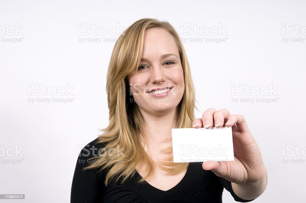 Young woman holding business card royalty-free stock photo