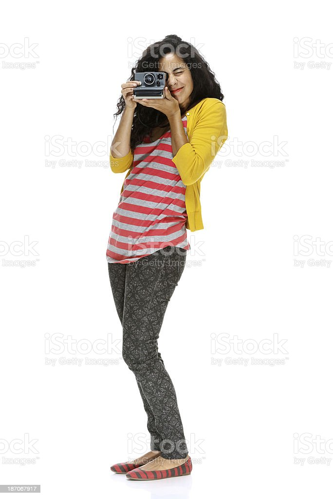 Young woman holding camera royalty-free stock photo
