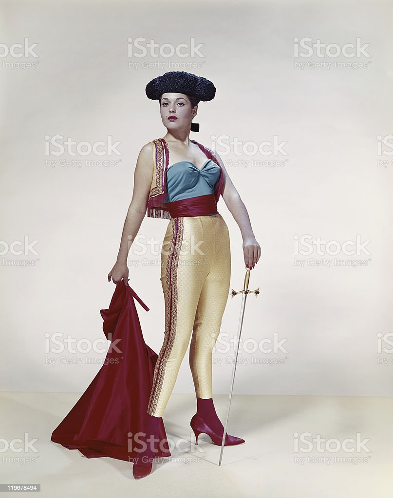 Young woman holding cape and sword, portrait stock photo