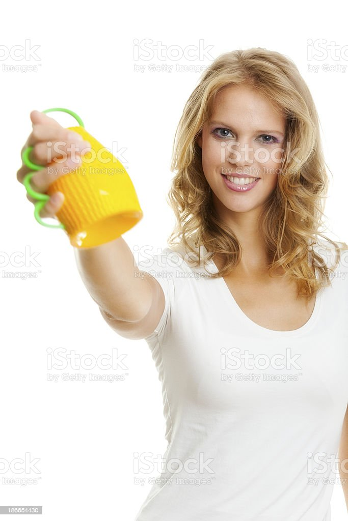 Young woman holding Caxirola stock photo