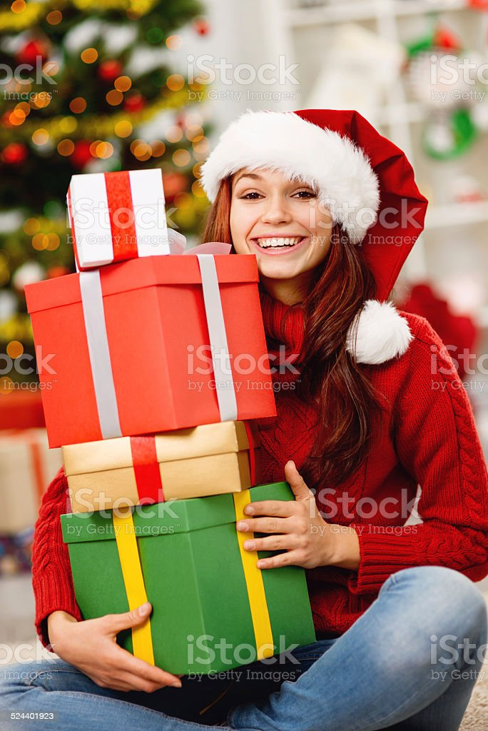Happy young girl with christmas boxes