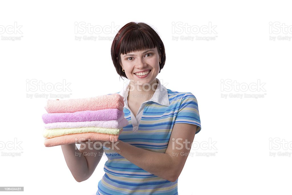 Young woman holding clean towels. royalty-free stock photo
