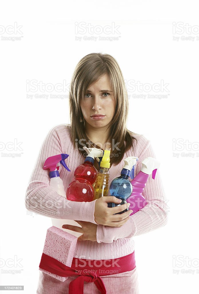 Young woman holding cleaning supplies royalty-free stock photo