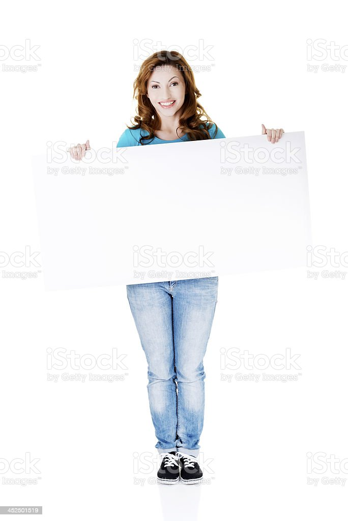 Young woman holding copy space. royalty-free stock photo