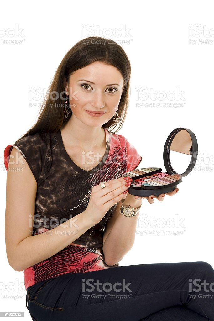 Young woman holding  cosmetic palette royalty-free stock photo