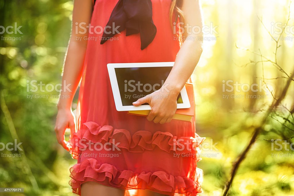 Young Woman Holding Digital Tablet royalty-free stock photo