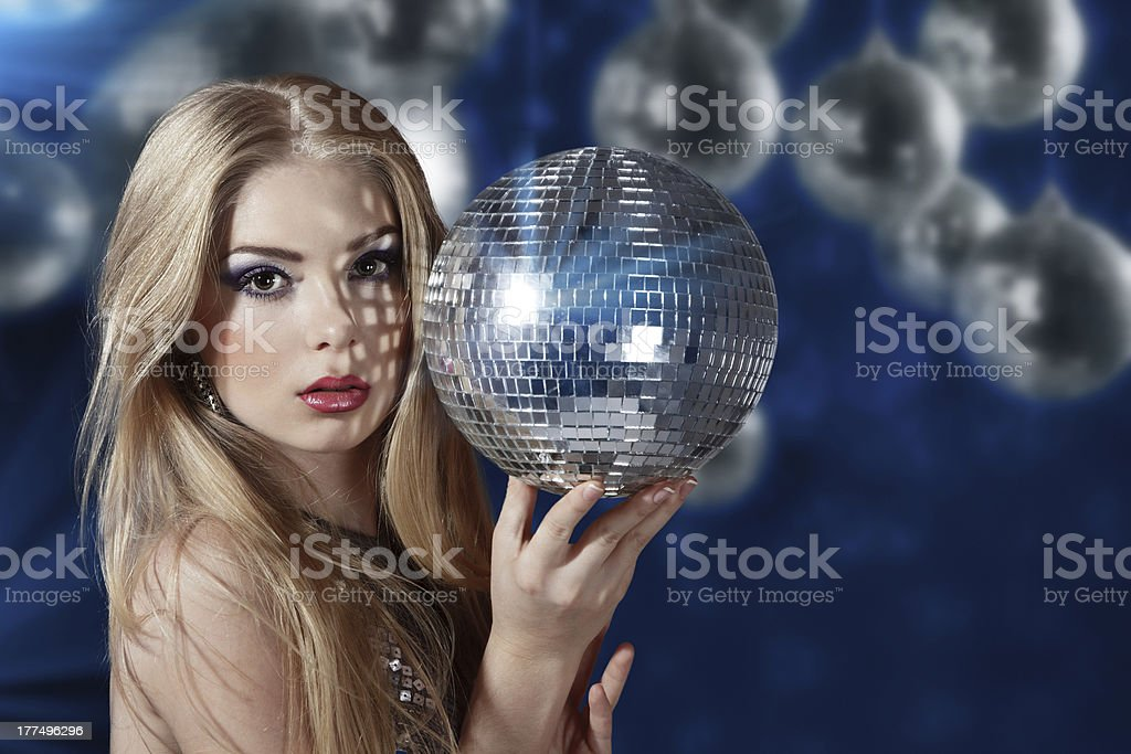 Young woman holding disco ball royalty-free stock photo