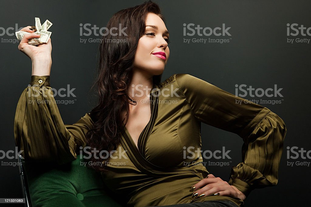 Young woman holding dollar bills stock photo