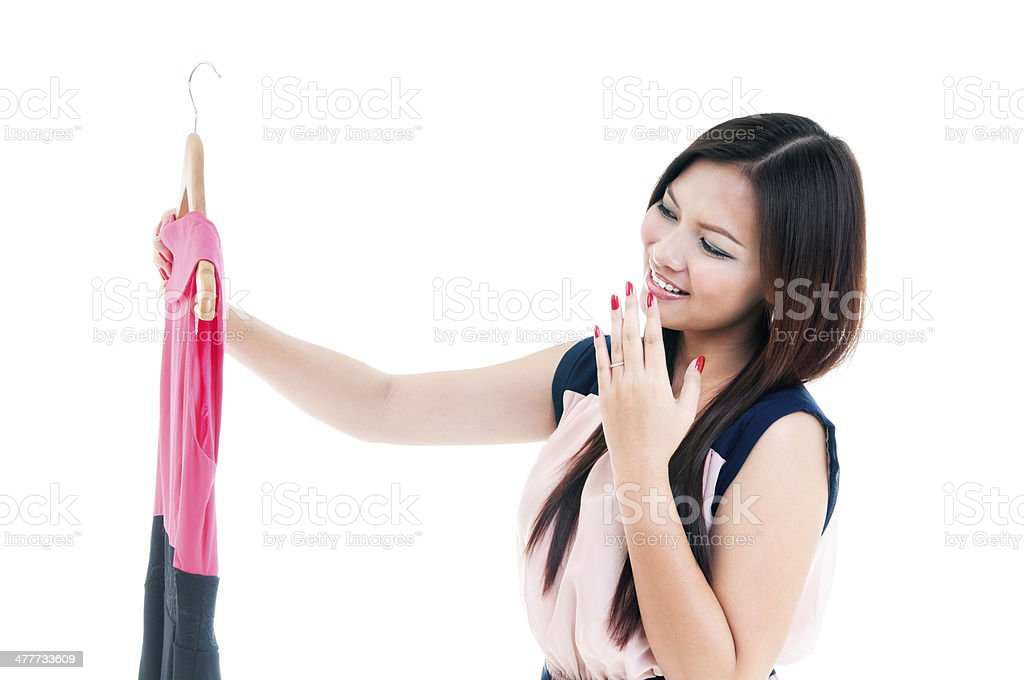Young Woman Holding Dress stock photo