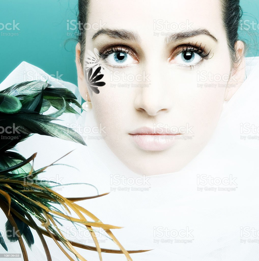 Young Woman Holding Feathers stock photo