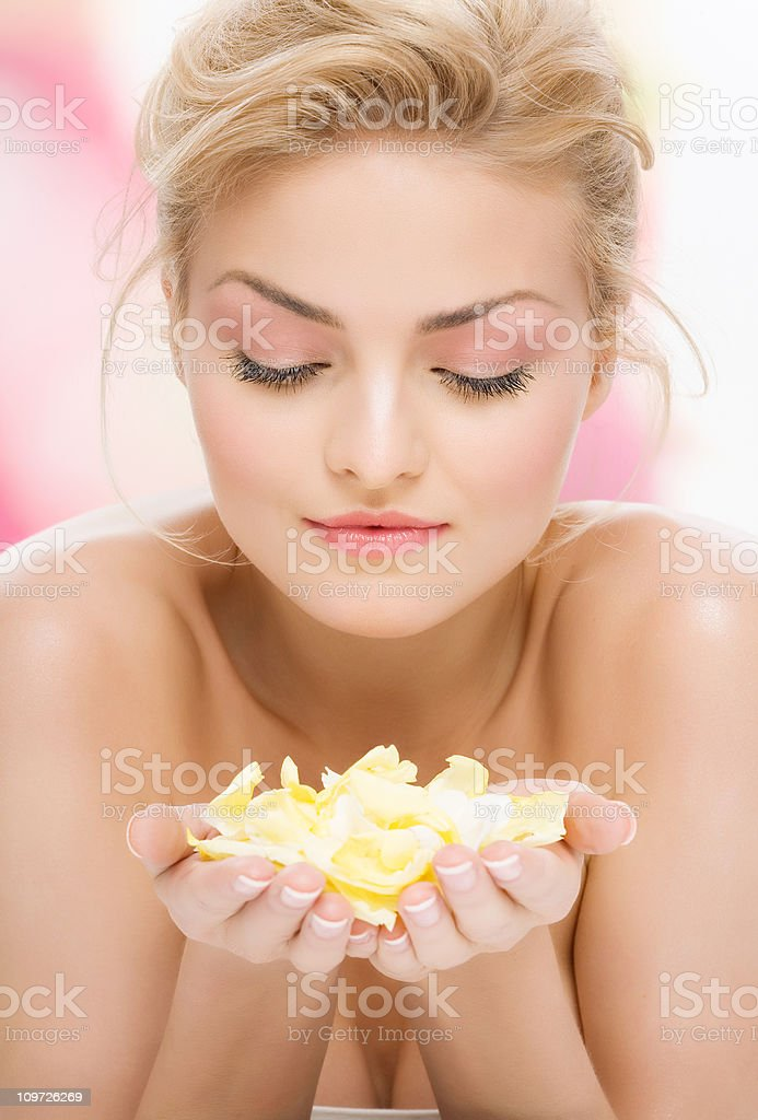 Young Woman Holding Flower Petals royalty-free stock photo