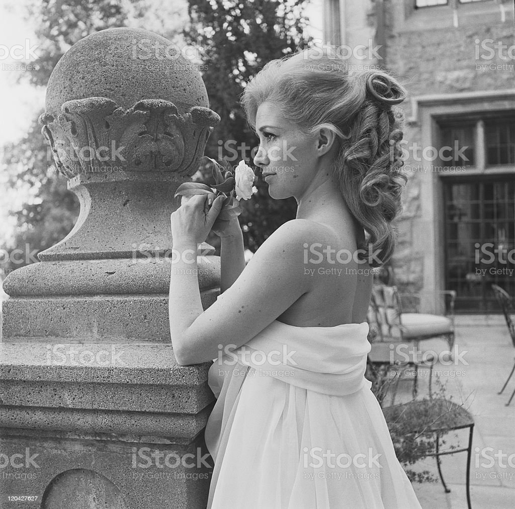 Young woman holding flower stock photo
