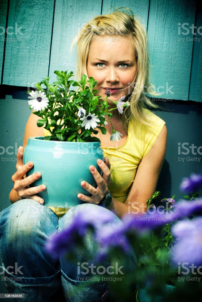 Young Woman Holding Flower Pot stock photo