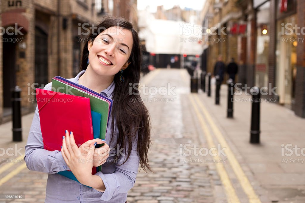 young woman holding folders royalty-free stock photo