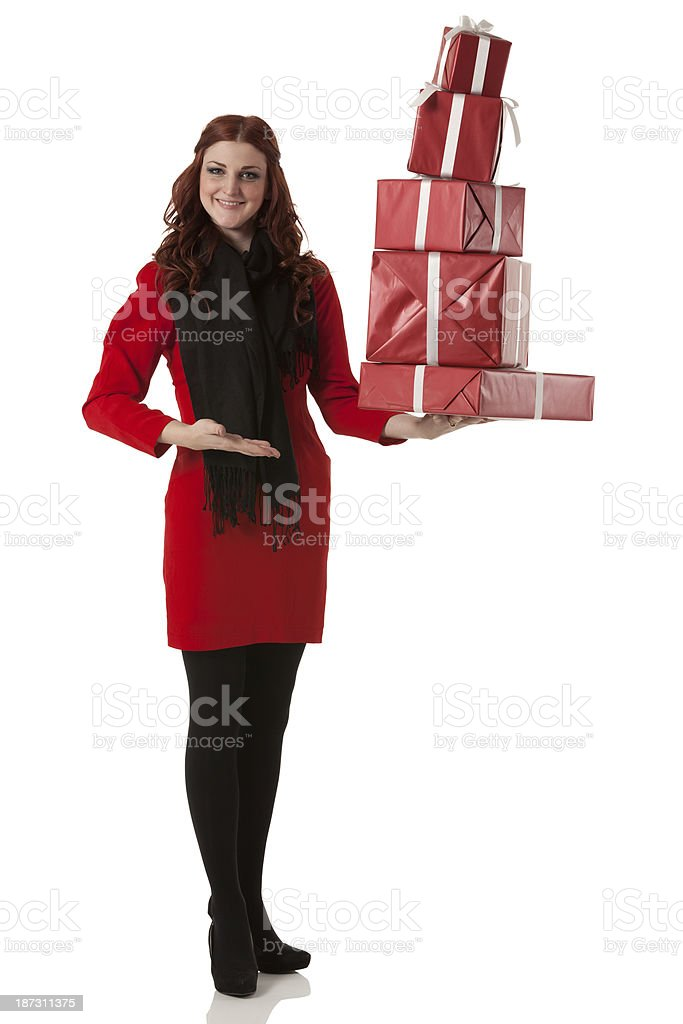 Young woman holding gift boxes royalty-free stock photo