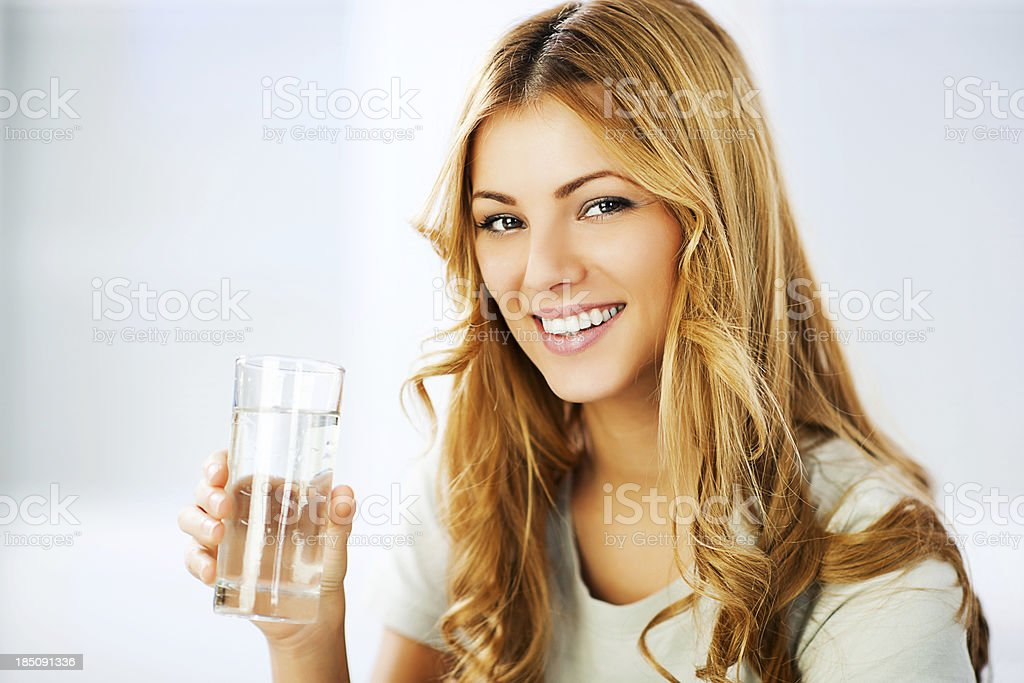 Young woman holding glass with Purified Water. stock photo