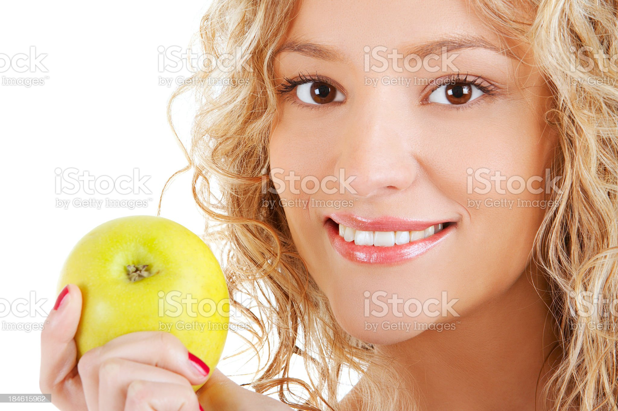 Young Woman holding green fresh apple royalty-free stock photo