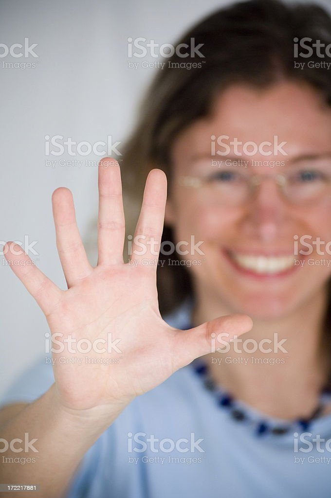 Young woman holding hand stock photo