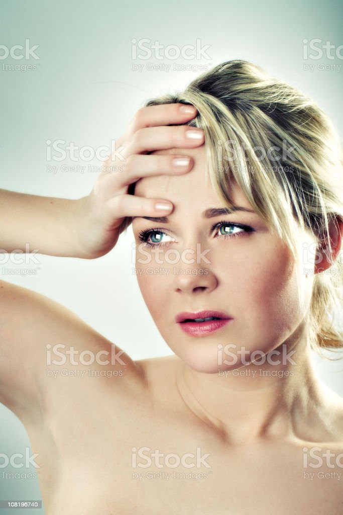 Young Woman Holding Head royalty-free stock photo
