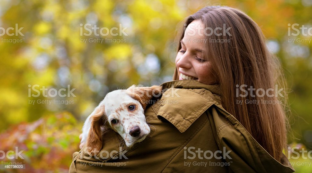 Young woman holding her English Setter puppy,  Oslo Norway stock photo