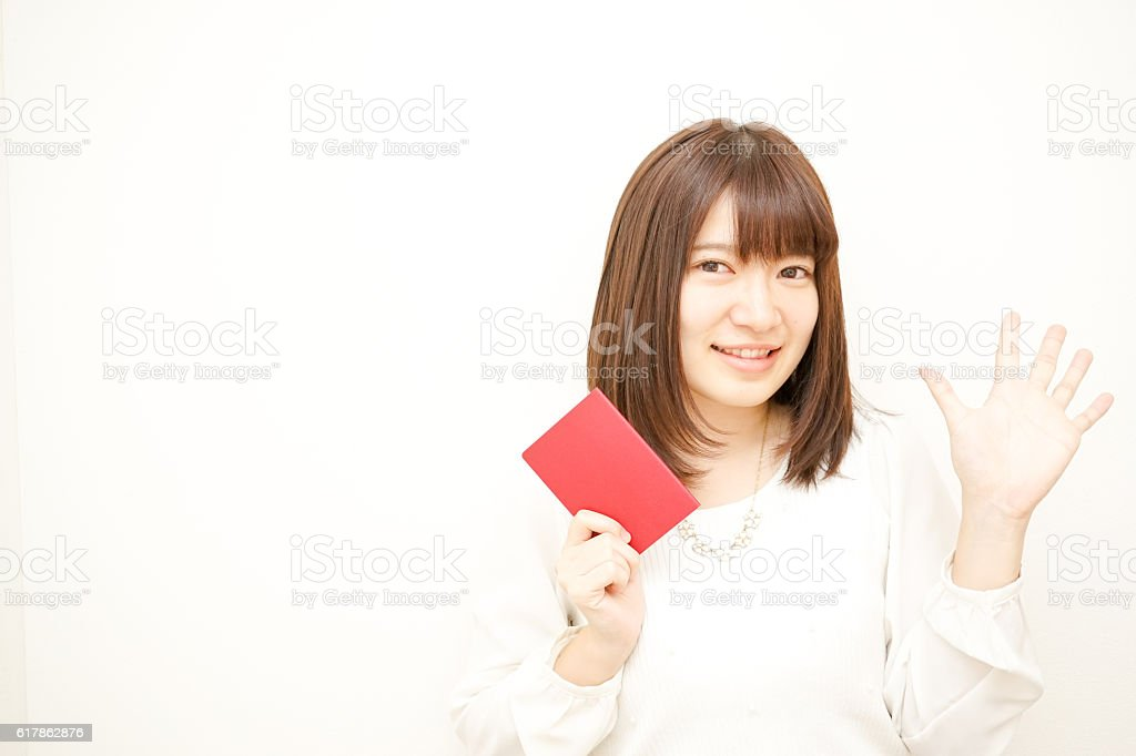 Young woman holding her passport with smile stock photo
