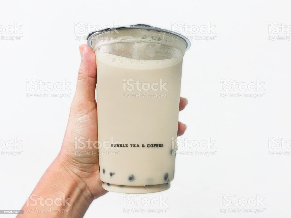 Young woman holding iced coffee with bubble tea toppings stock photo