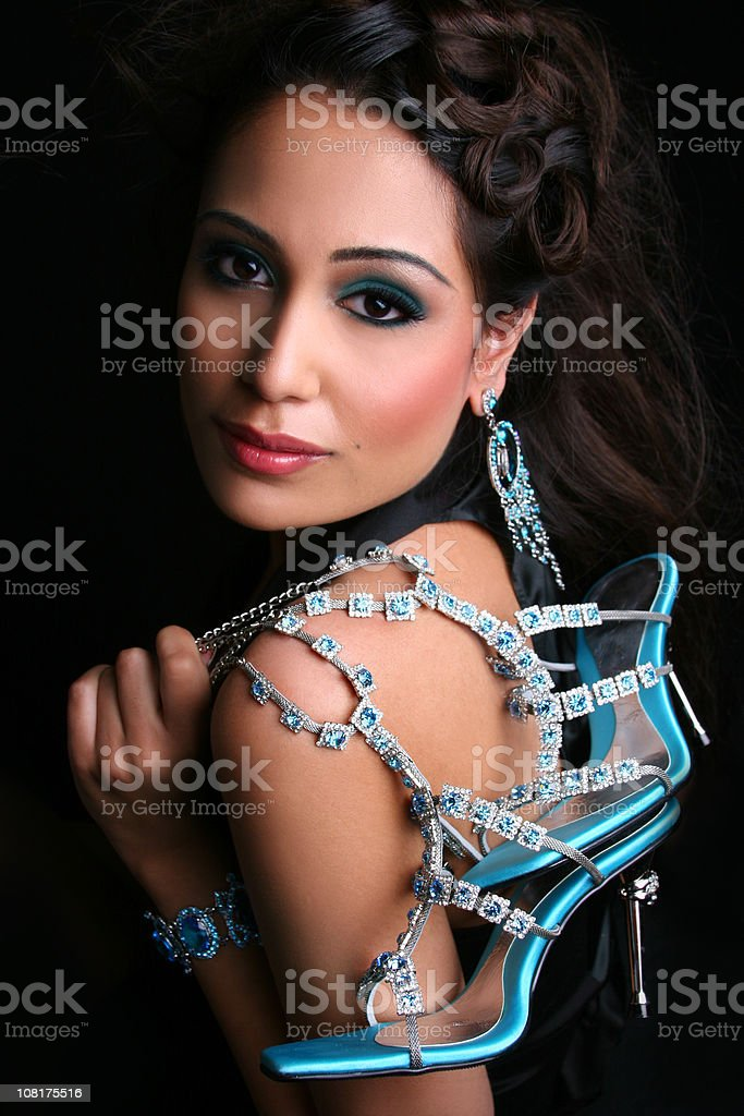Young Woman Holding Jeweled Sandal High Heels royalty-free stock photo