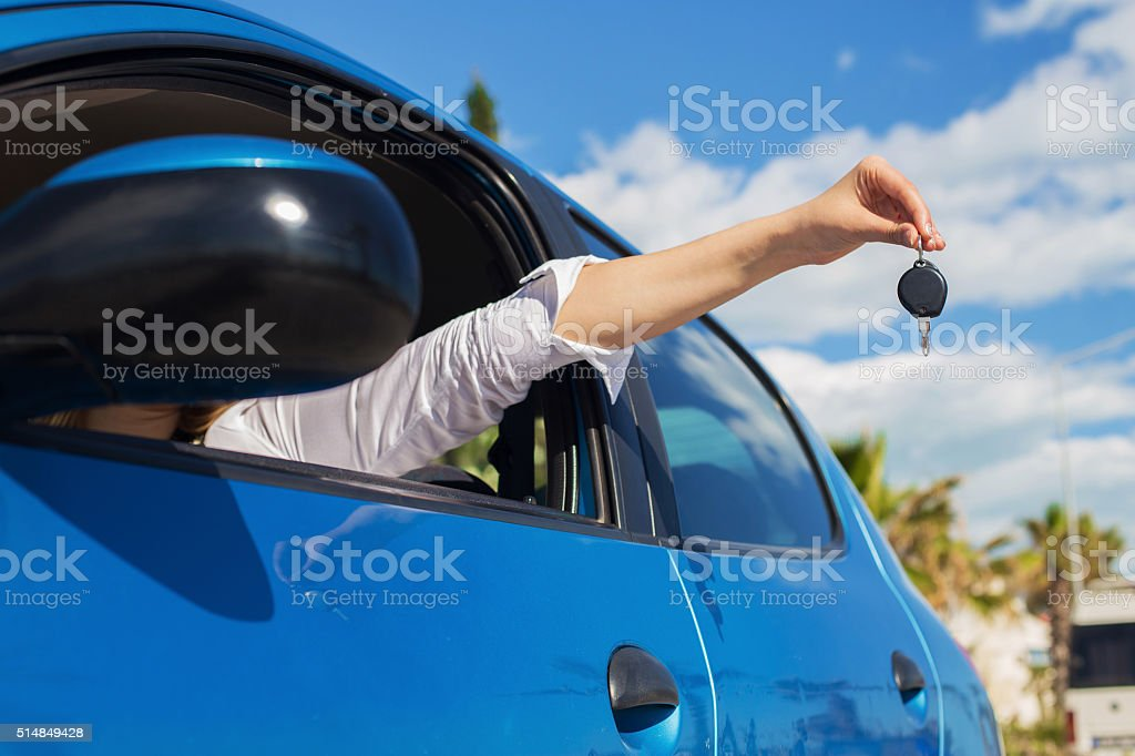 Young woman holding keys of new car stock photo