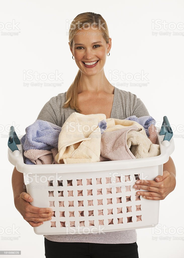young woman holding laundry basket stock photo