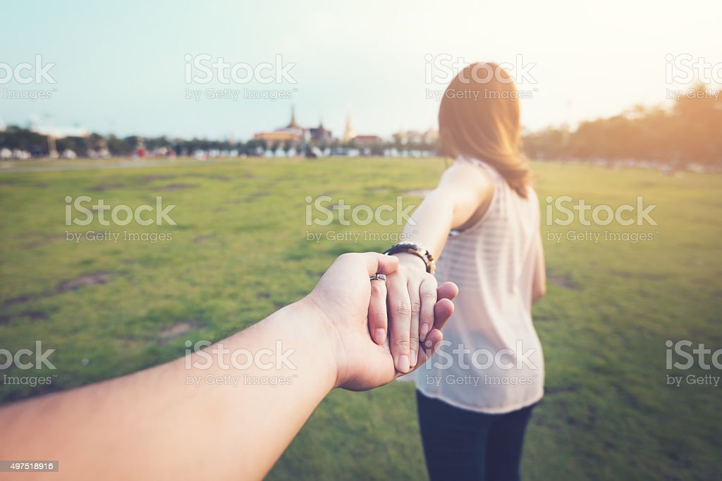 Young woman holding man hand , vintage processed. stock photo