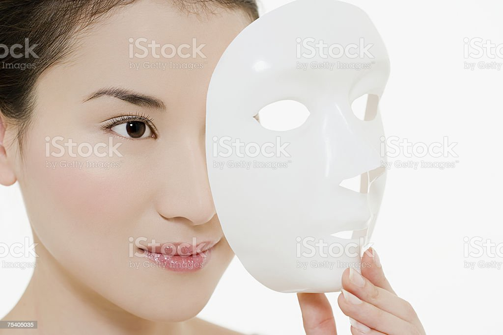 Young woman holding mask royalty-free stock photo