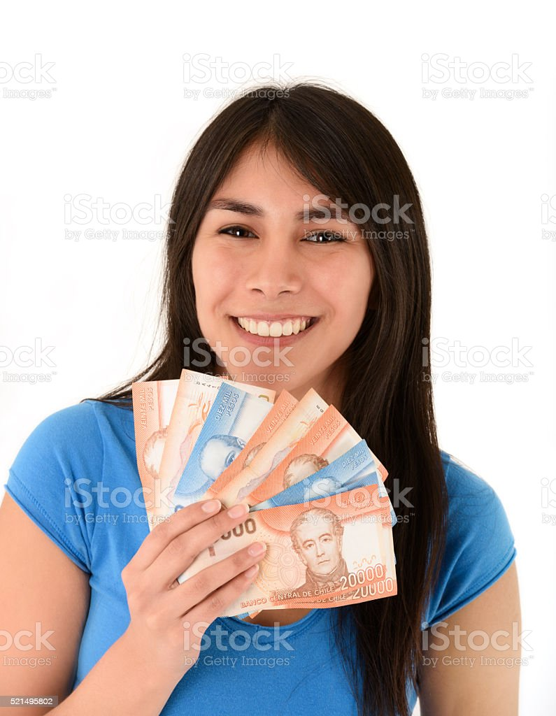 Young woman holding money from Chile stock photo