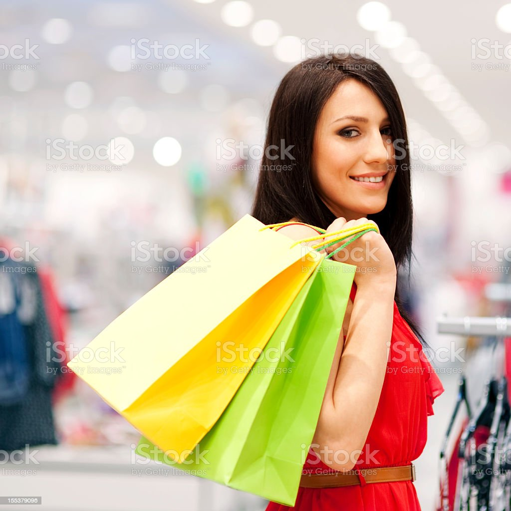 A young woman holding multiple shopping bags royalty-free stock photo