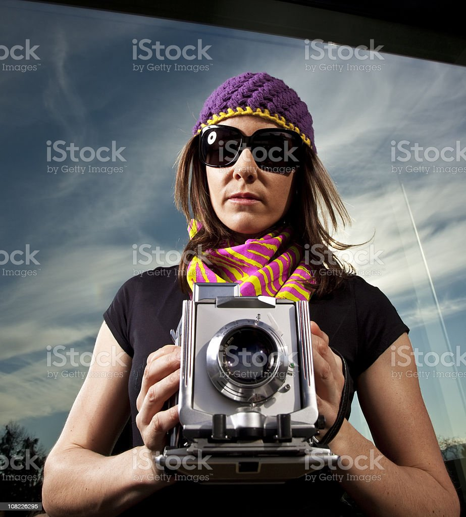 Young Woman Holding Old Vintage Camera stock photo