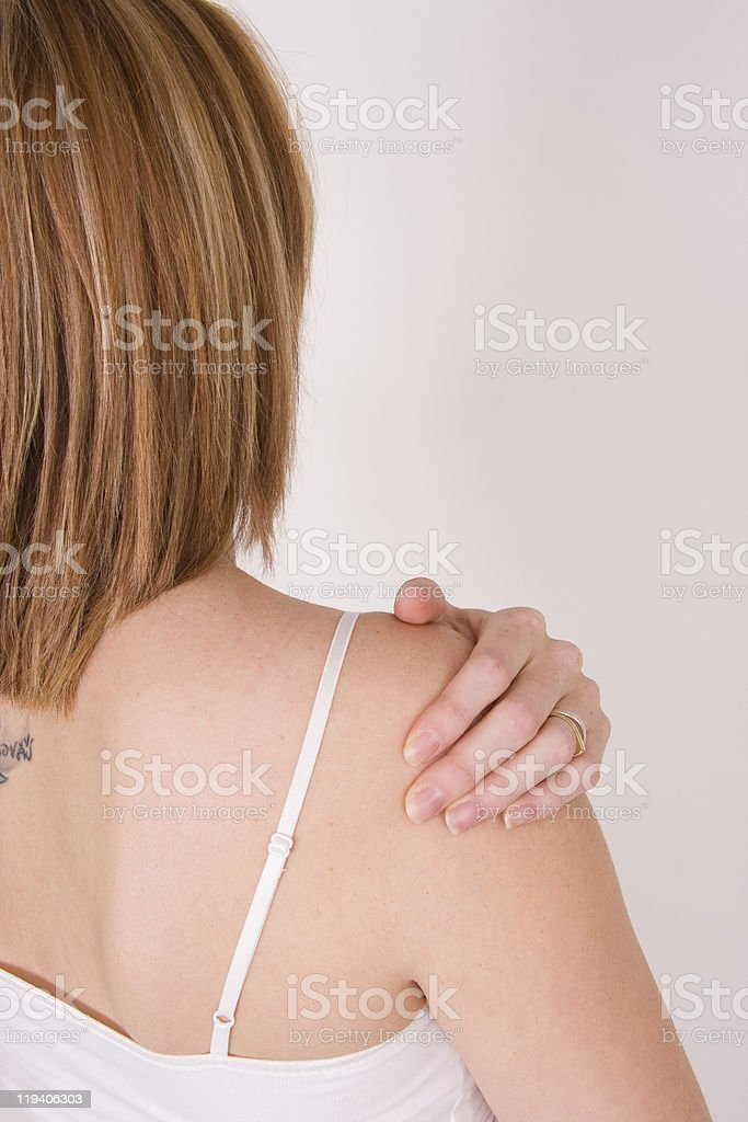 Young woman holding painful shoulder royalty-free stock photo