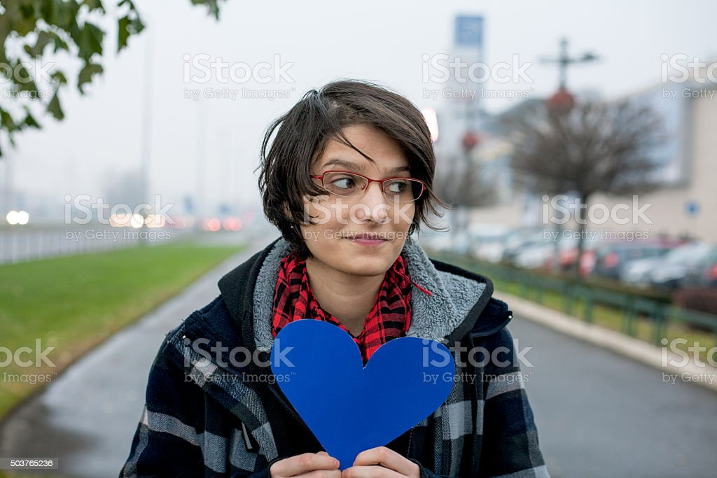 Young woman holding paper heart royalty-free stock photo