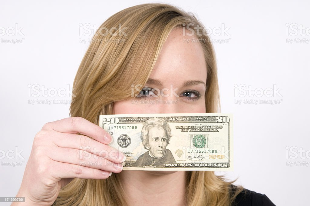 Young woman holding paper note over mouth royalty-free stock photo