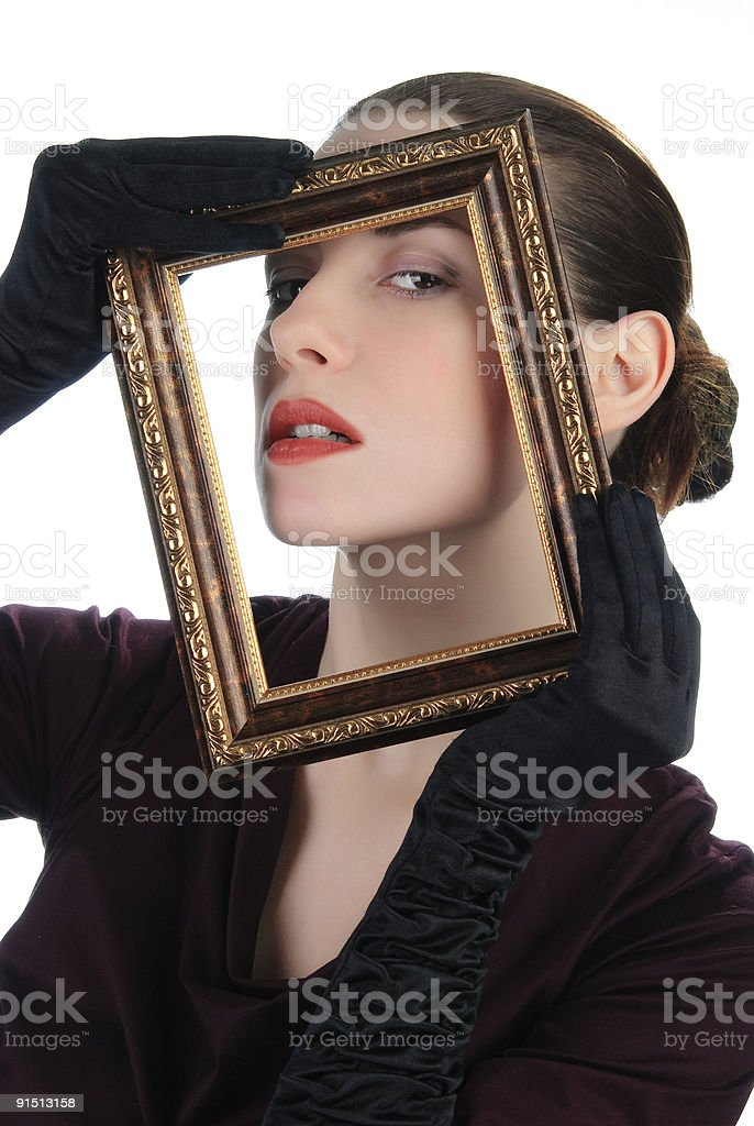 Young woman holding picture frame royalty-free stock photo
