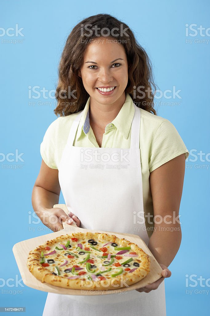 Young woman holding pizza royalty-free stock photo
