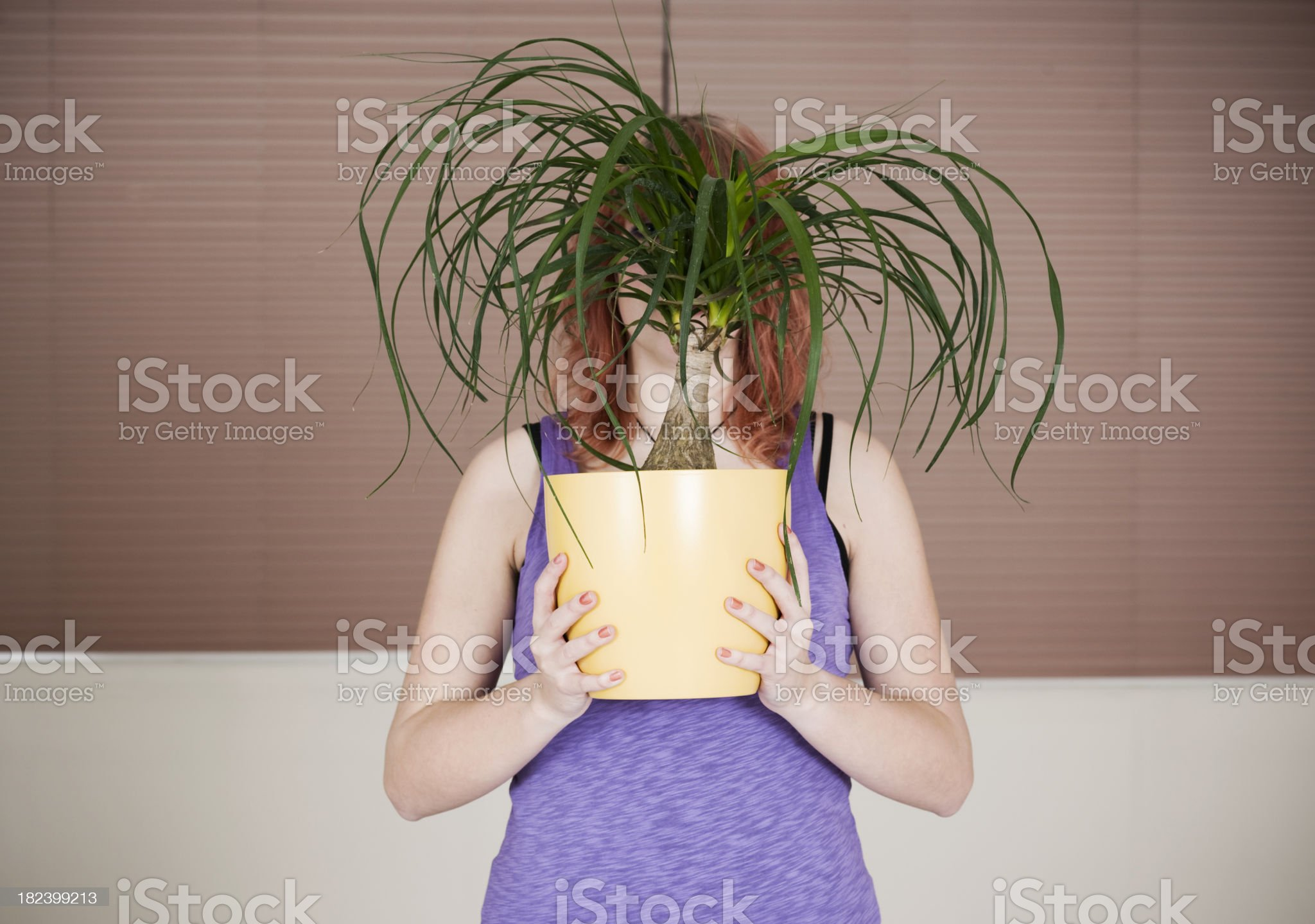 Young woman holding plant royalty-free stock photo