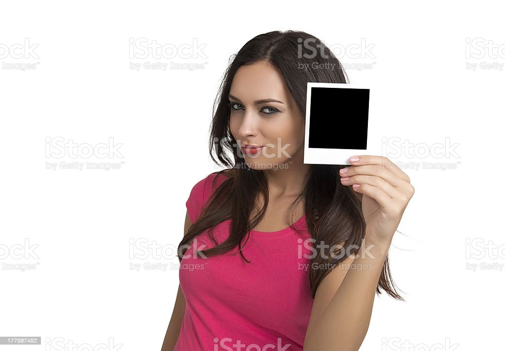 Young woman holding polaroid picture royalty-free stock photo