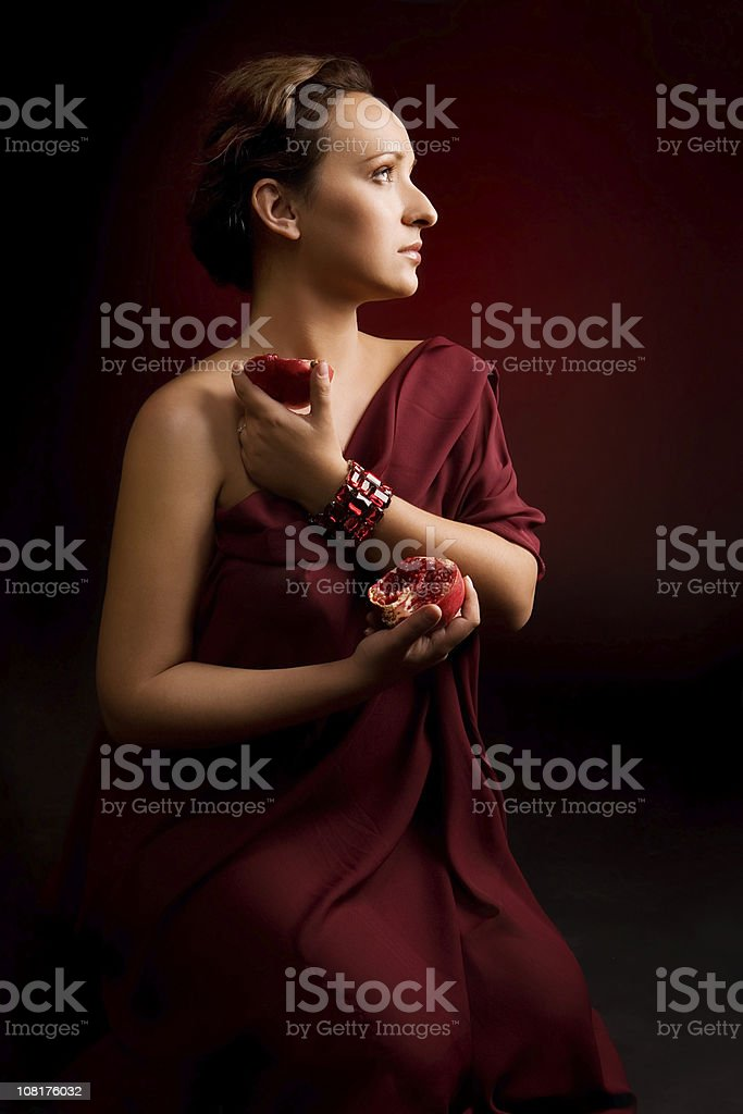 Young Woman Holding Pomegranate royalty-free stock photo