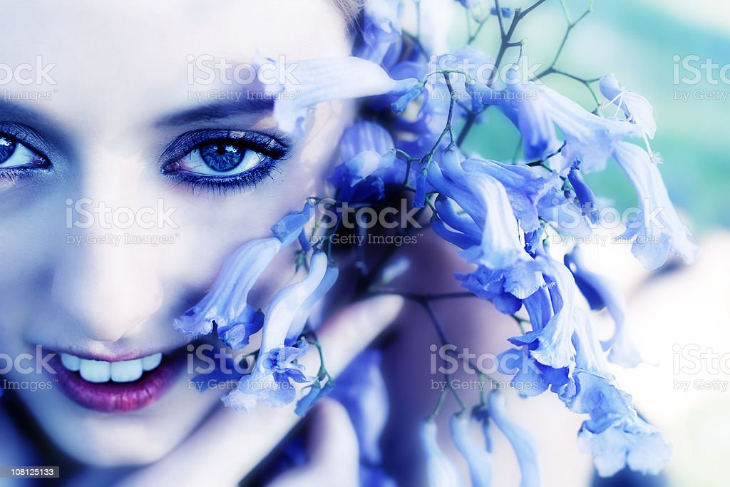 Young Woman Holding Purple Flowers royalty-free stock photo