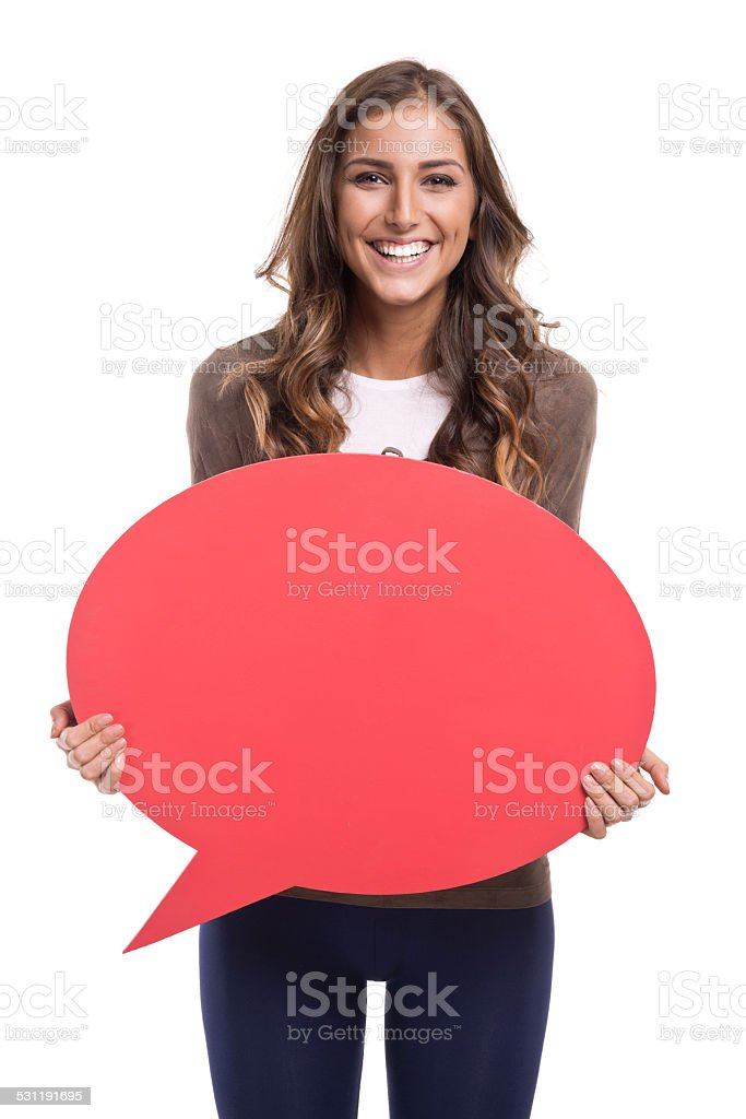Young woman holding red speech bubble stock photo